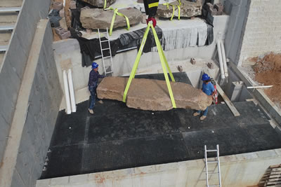Arkansas State University West waterfall, Initial lower waterfall boulder being set