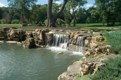 Lake Geneva Wisconsin 4' tall waterfall and grotto into lower pond