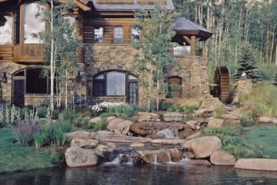 Silverthorne Colorado Front View    Of Water Wheel And Stream